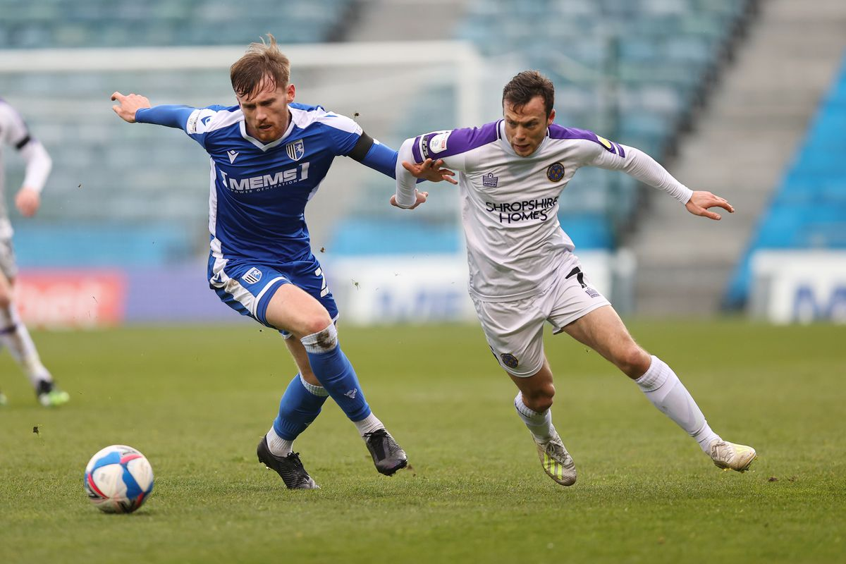 Shaun Whalley of Shrewsbury Town and Robbie Cundy of Gillingham. (AMA)