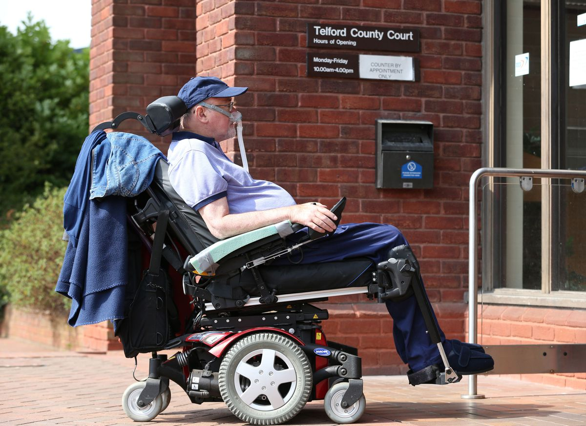 Terminally-ill Noel Conway, 67, arriving at Telford County Court with supporters to view a video link of a judicial review on assisted dying.