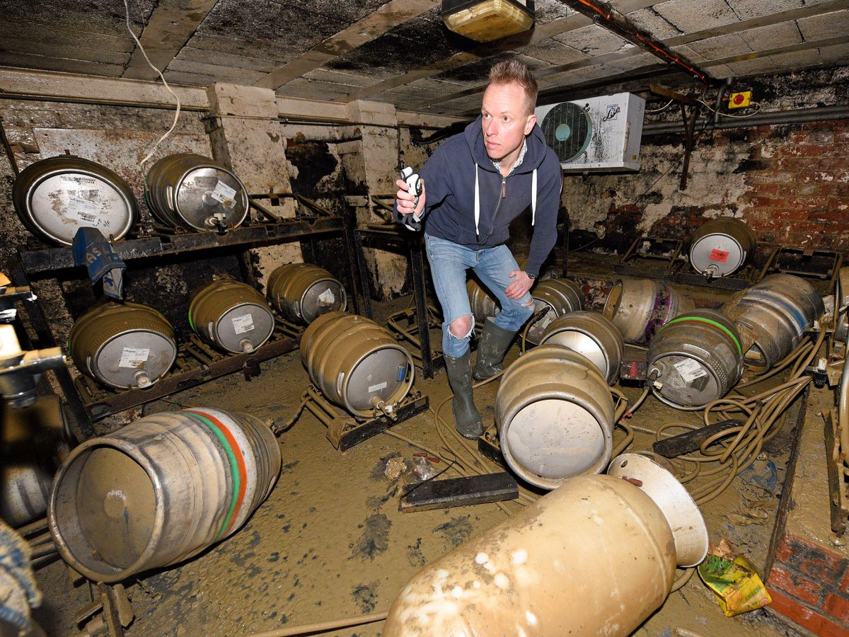 Ollie Parry, owner of The Salopian bar, Shrewsbury, surveys the cellar of the pub after the extensive recent flooding