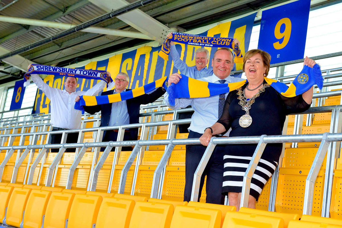 Celebrations for the mayor Jane Mackenzie, chief executive Brian Caldwell, Mike Davis and Roger Groves of the Supporters' Parliament and Michael Burnett, MD of Ferco Seating