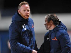 Gavin Cowan greets Brackley manager Kevin Wilkin
