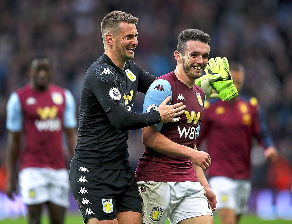 Aston Villa's goalkeeper Tom Heaton (left) and John McGinn during the Premier League match at Villa Park, Birmingham.