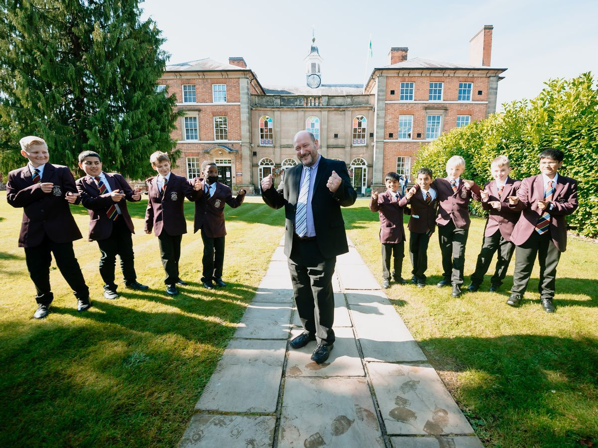 Don and students when he returned to Haberdashers' Adams Grammar School as a milloinaire