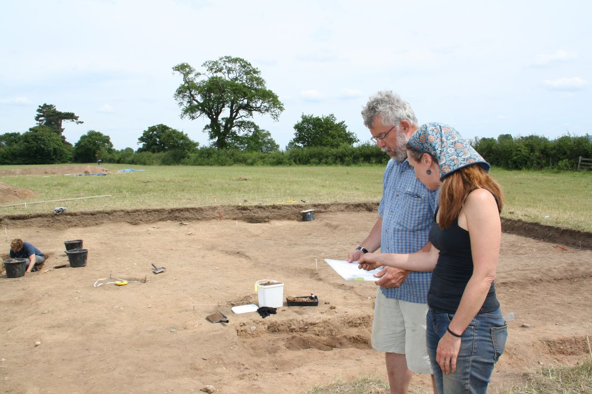 Dr Roger White and Janine Young look at plans of the site.