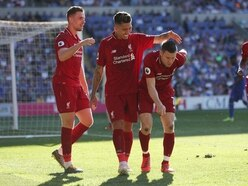 Liverpool's James Milner pretends to walk like an old man after scoring penalty