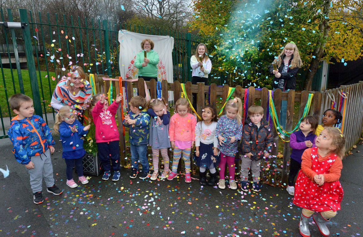 Staff Tina Mitchell, Michelle Harper, Cara Moss and Georgie Stanton let off confetti with the pre-school children