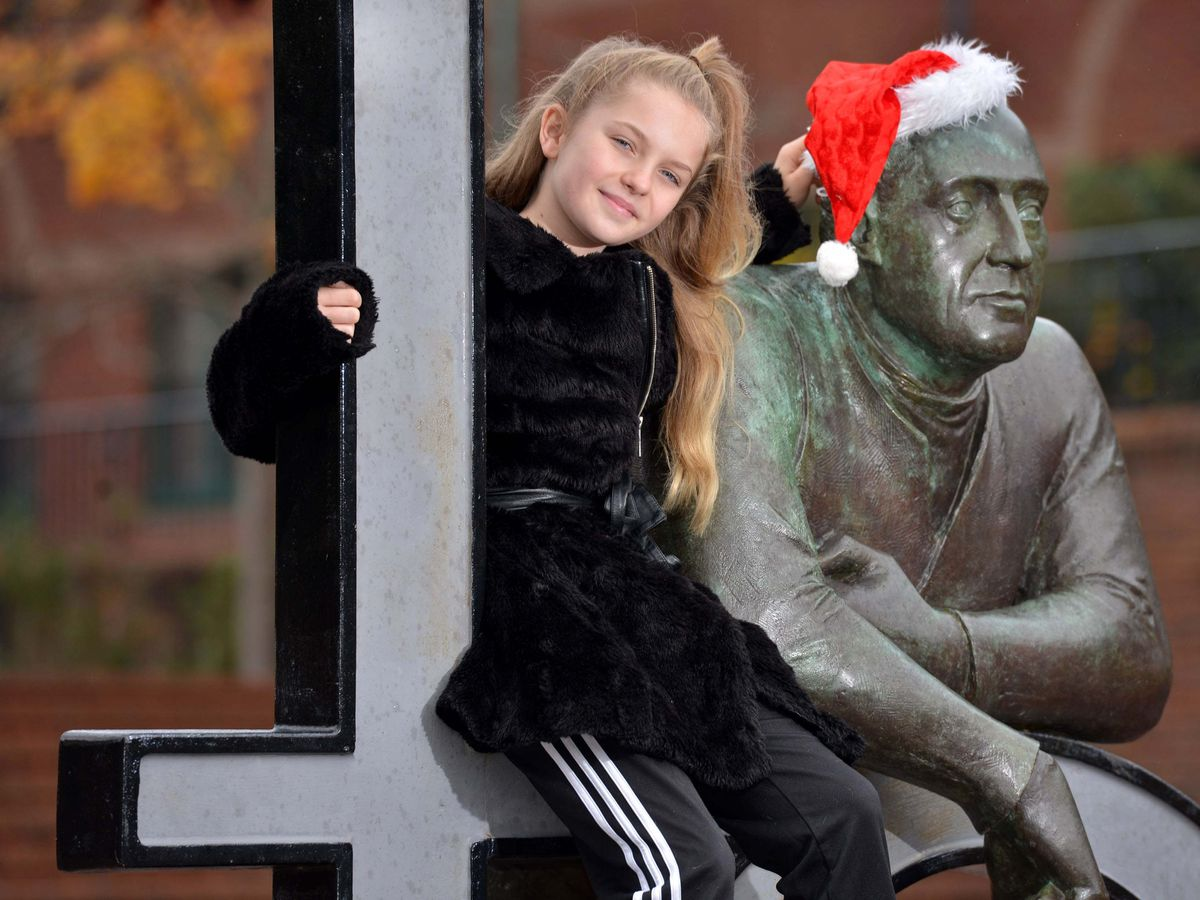 Meesha Garbett poses by the town's landmark Telford statue – she was home this weekend to visit family and celebrate a birthday