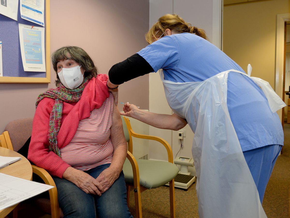 Reporter Sue Smith gets the Covid vaccine