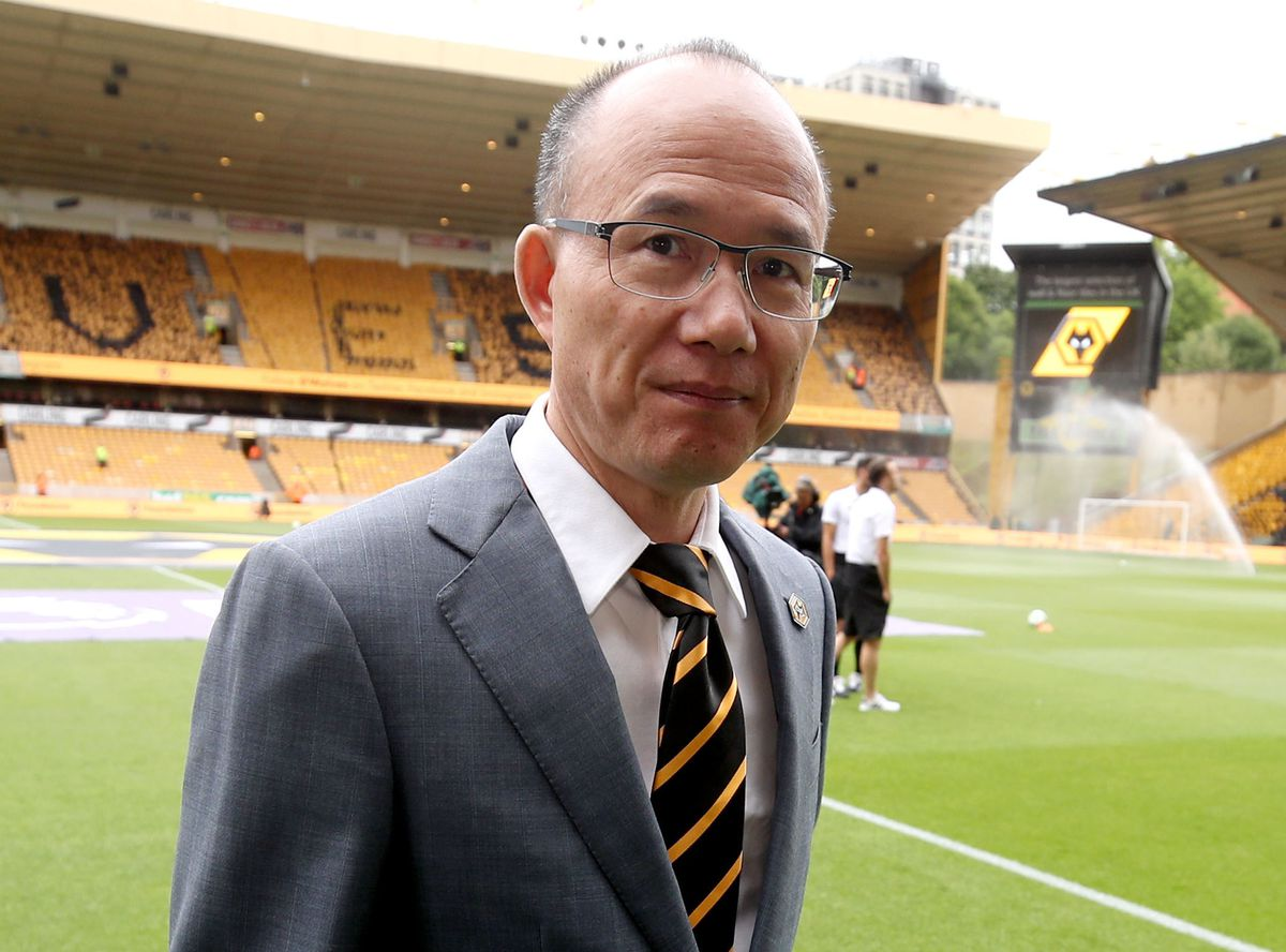 Fosun chairman Guo Guangchang on the pitch at Molineux