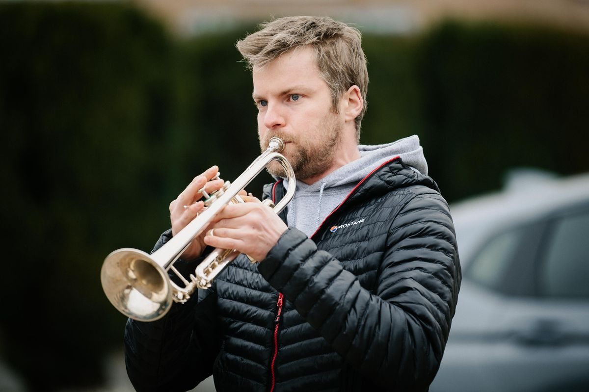 A trumpeter plays to mark Lina's birthday