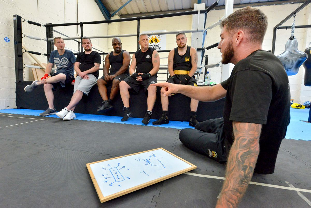 Head coach Joe Lockley talking with members of the Bright Star Boxing Academy in Shifnal.
