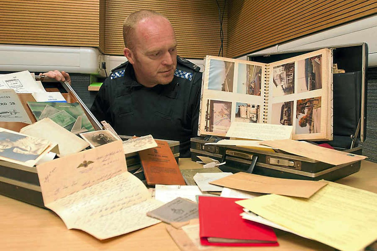 Constable Mick Sturland with the two cases which contain items of RAF memorabilia. Pictures: Laura Dutfield