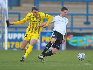 Andy Bond of Telford battles for the ball with Jack Sampson