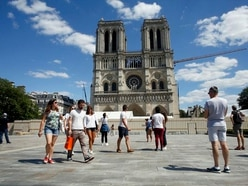 Notre Dame forecourt opens to public a year after blaze damaged cathedral