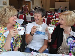 Oldest woman to row the Atlantic Ocean Di Carrington, centre, with vice president of Much Wenlock WI Kim Leitch and president Sheila Hall
