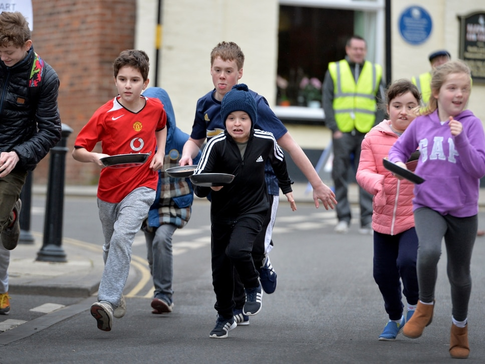 Hundreds cheer on for Great Dawley Pancake Race - with pictures