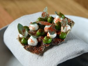 A fish skin canape is one of the eye-catching and delicious dishes available at Pensons