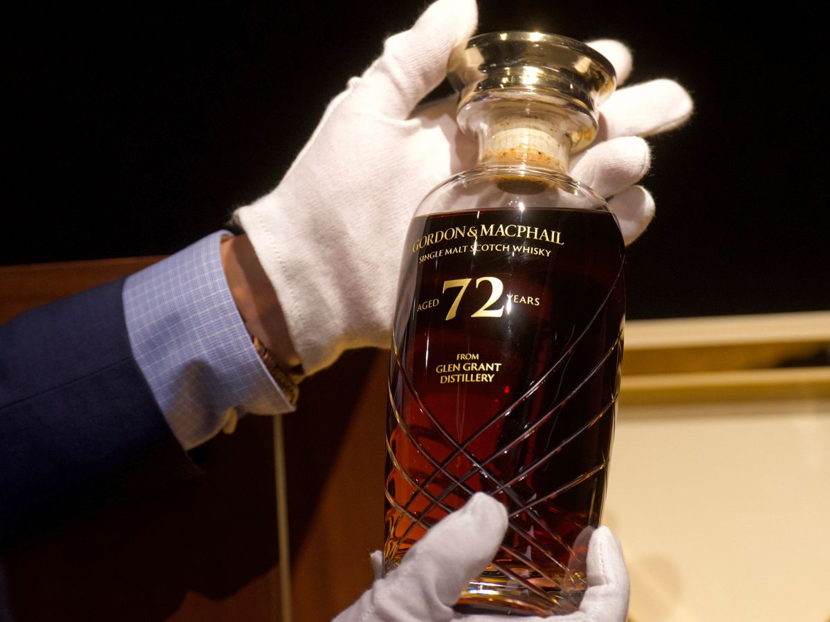 A 72-year-old bottle of Glen Grant single malt whisky from Scotland displayed at a Bonhams auction preview in Hong Kong
