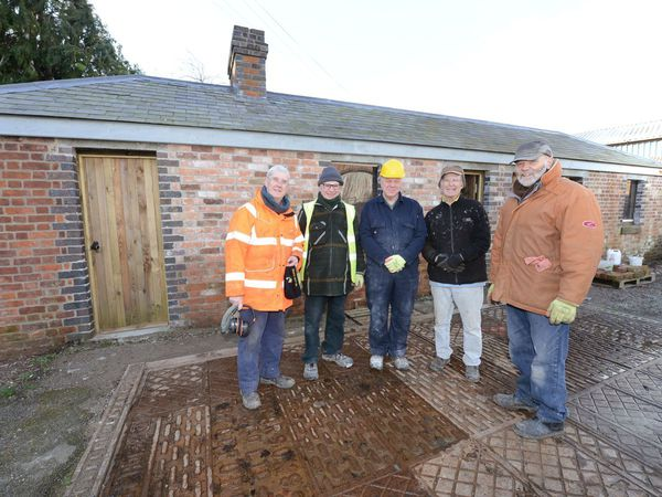 The team taking part in the restoration of the weighbridge building on the old railway site in Bishops Castle. Pictured, from left, are Peter Broxholme, Roger Dalton, Mike Boyd, David O'Neill and Malcolm Reeves