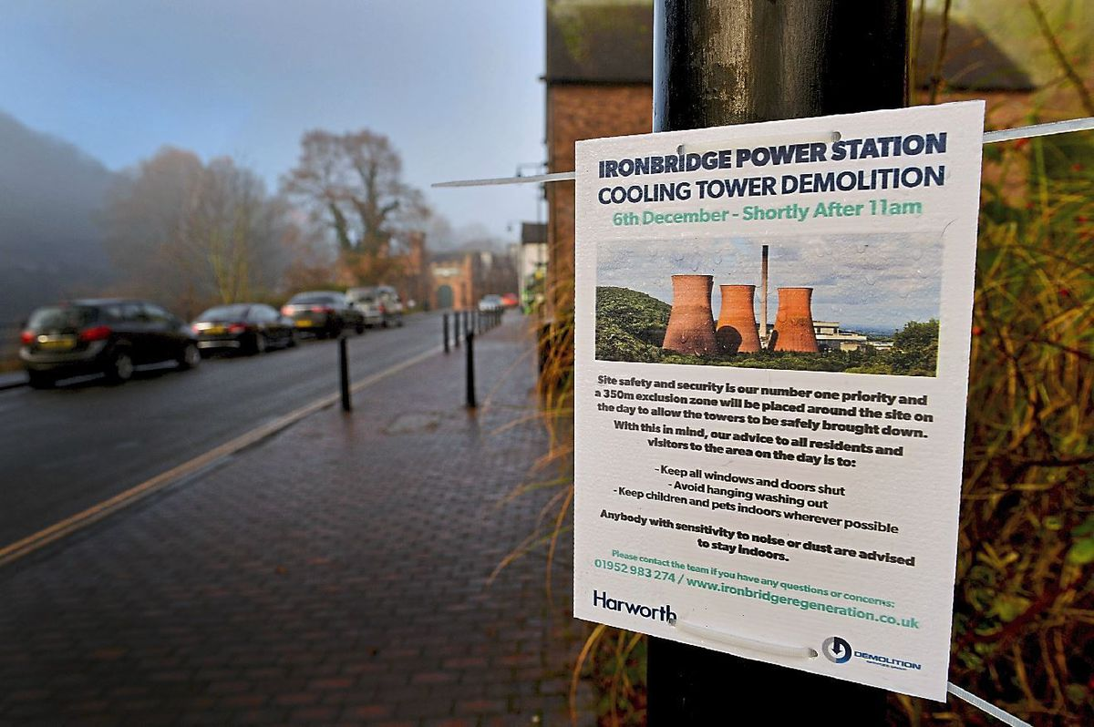 A poster announcing the towers' demolition