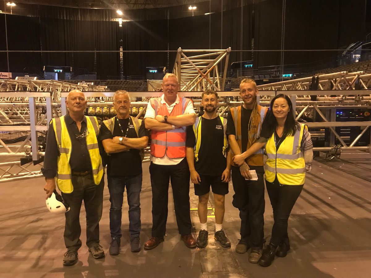 The Arenas' apprentices with their assessors and apprenticeship co-ordinator