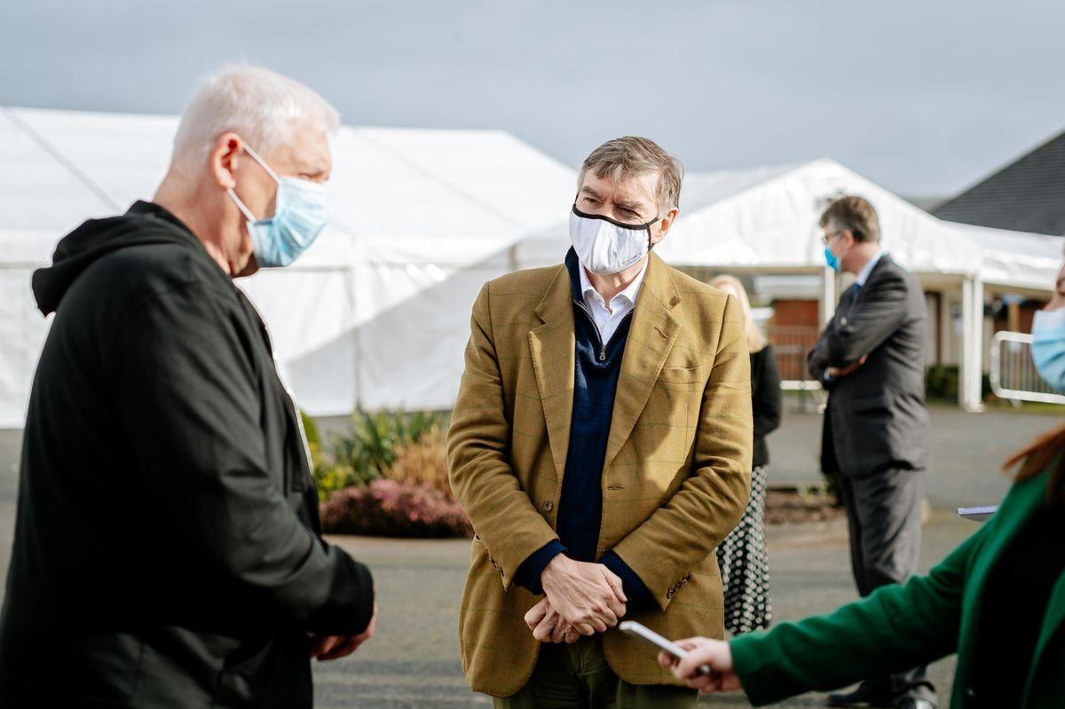 Vaccine recipient Malcolm Bunn with Philip Dunne MP