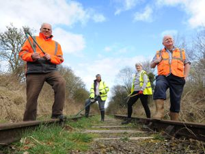 Working on the railway line, are volunteers, (left-right) Nick Culliford, Joanne Knight, Anne Boden, and Norman Knight..