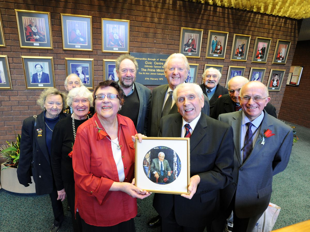 Joy holding a framed picture of Lord Callaghan, whom she had nursed, at Wolverhampton Civic Centre in 2013