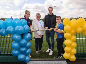 Dave Edwards officially opens the Shrewsbury Town in the Community 3G Pitch along with Masie-Mae Doherty of Shrewsbury Town Women's Academy, Leslie Picton of SCC and Thomas Nichols of the Lakelands Academy. (AMA)