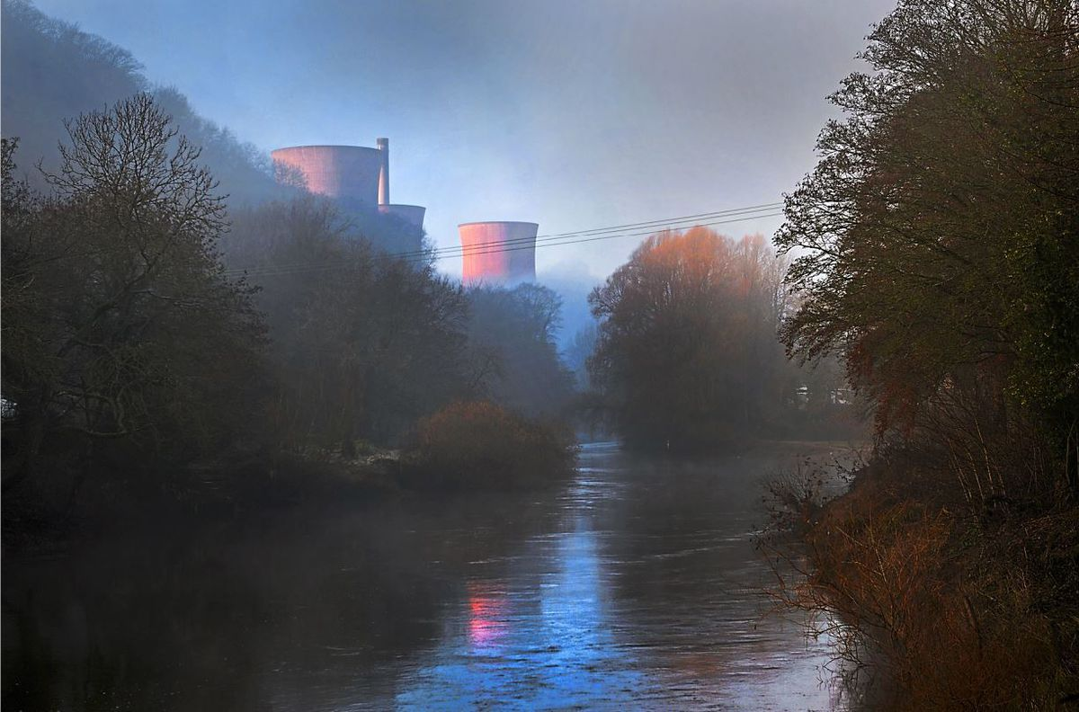 Waiting for their fate, the pink power station towers peak out from around the corner alongside the River Severn in an image taken during an early morning frost this week