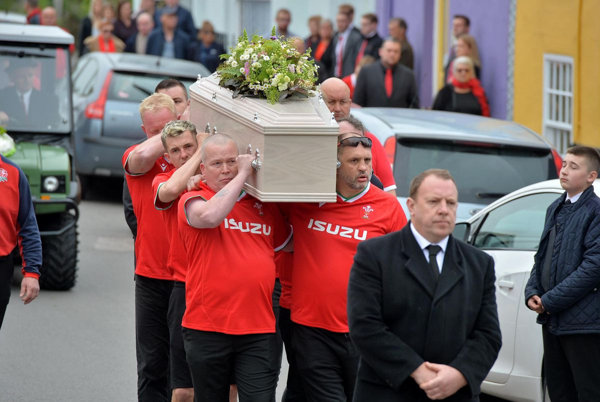 The pallbearers wore Welsh rugby shirts, with everyone asked to wear something red