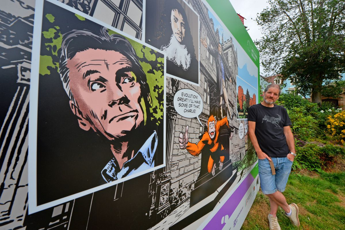 Walking Dead artist Charlie Adlard with the billboard he created as part of the Shrewsbury Comic Art Trail