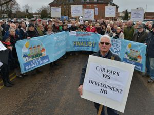SPROPSHIRE STAR ( JOHN SAMBROOKS ) 10/01/17  Adrian Tacchi, Member Secretary for Bridgnorth Chamber of Commerce pictured with locals protesting over the Old Smithfield development in Bridgnorth.                                                                                                                .              .                               .