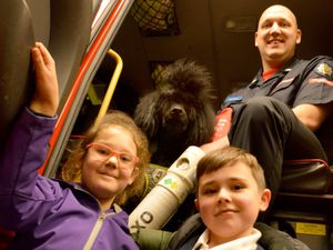 Brooklyn and Ethan Farrell with firefighter Paul Scott and the very lucky poodle, Boris