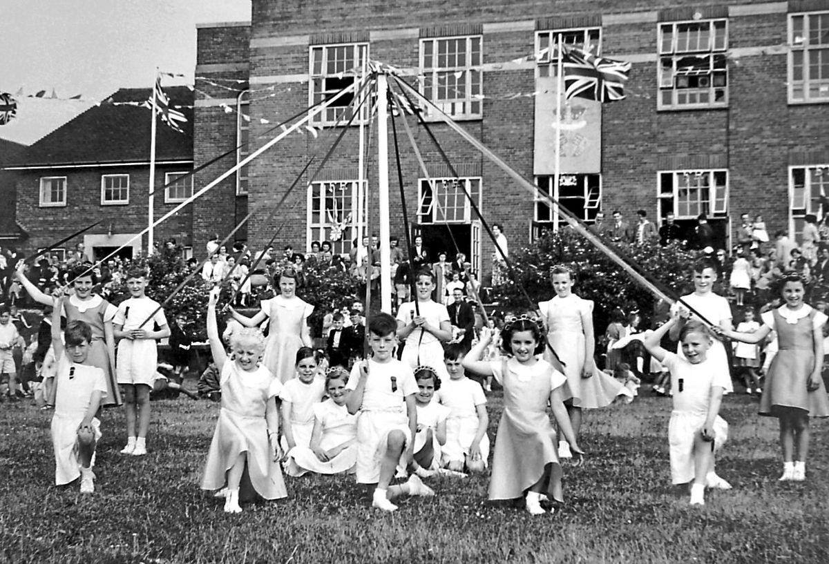 It's May, so time to get dancing around the maypole like these children in front of the old Madeley Modern School, later renamed the Abraham Darby School. The 1930s school building in the background was demolished in 2012. Just to confuse the issue these youngsters were not dancing round the maypole in May – this particular maypole was to celebrate the Coronation of the Queen in the summer of 1953. We know that one of the dancers was Ann Miles from Broseley.