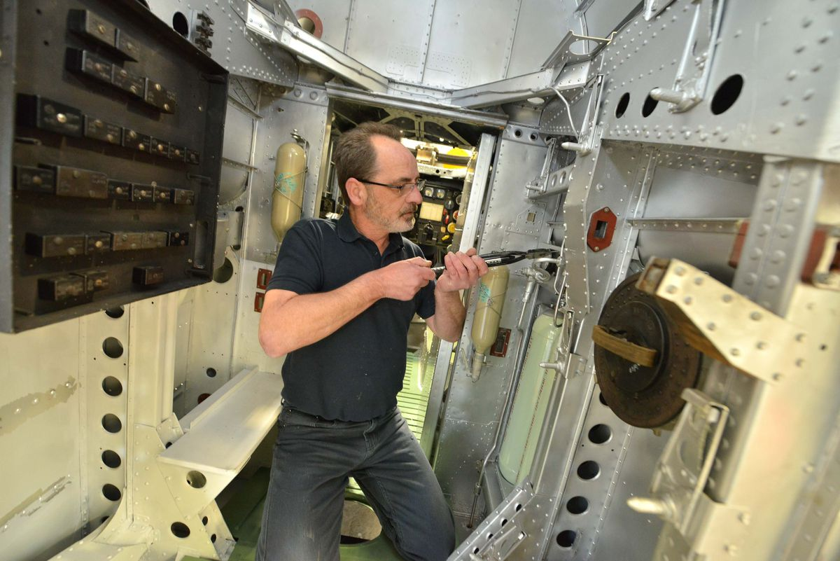 Aircraft Technician Dave Carr working on the restoration of a Handley Page Hampden