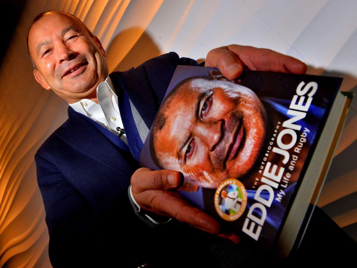 Eddie Jones with his new book