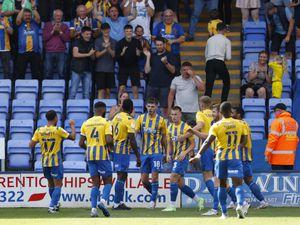 Tom Bloxham of Shrewsbury Town celebrates with his team mates after scoring a goal to make it 1-1.