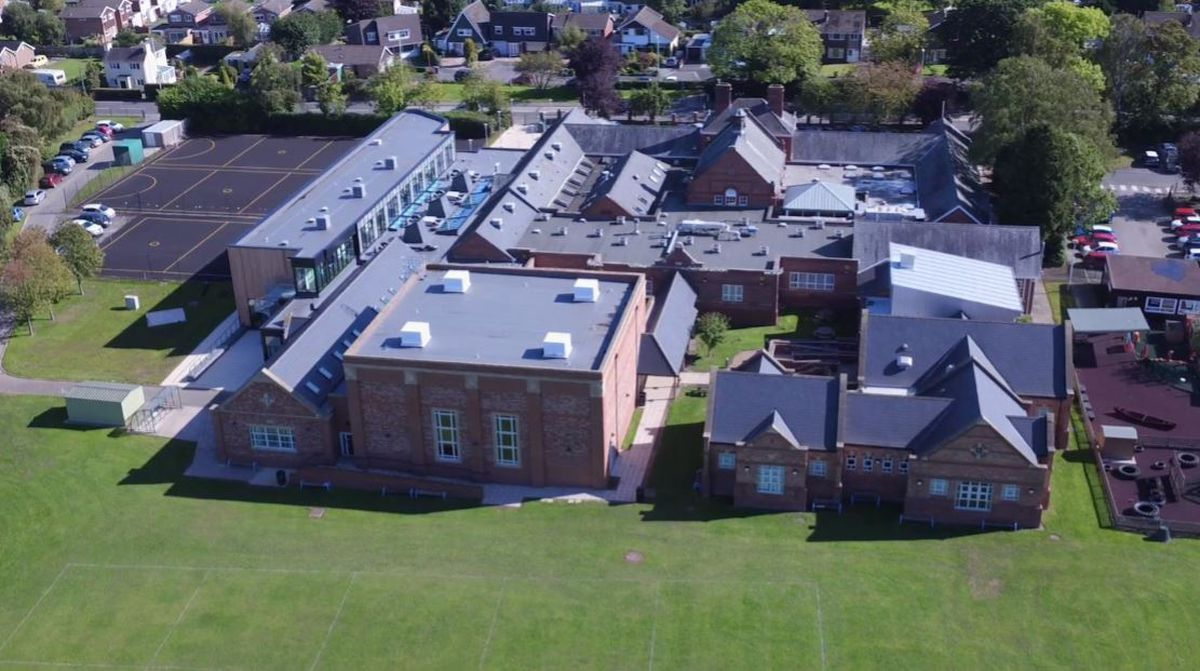 Newport Girls' High School. The planned extension partly covers a courtyard towards the back of the building.