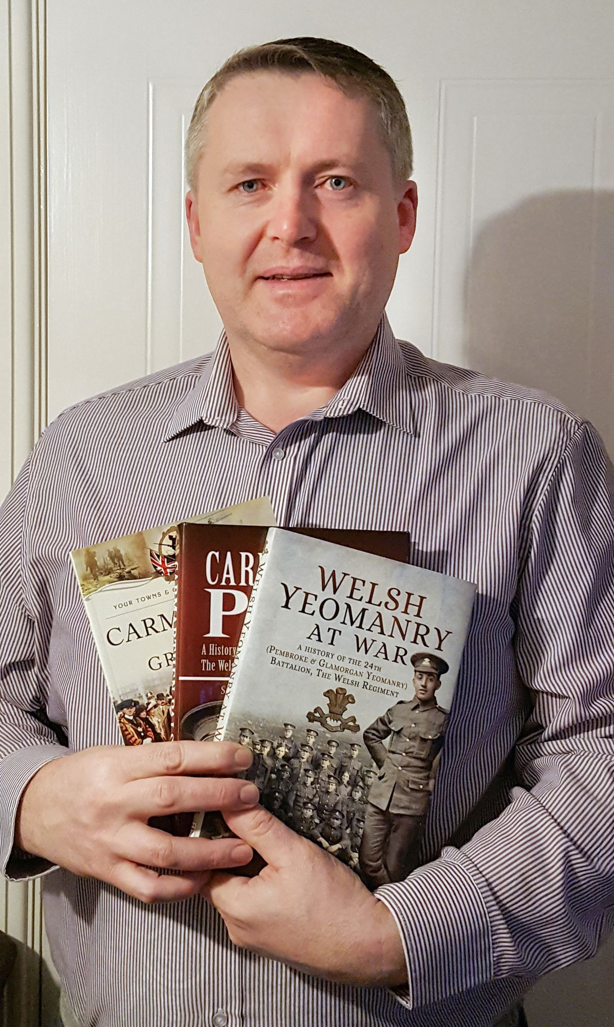 Shrewsbury's Steven John with some of his books.