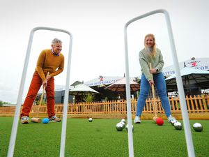 Founder Clive Knowles, and marketing manager Alice Turnbull on the green
