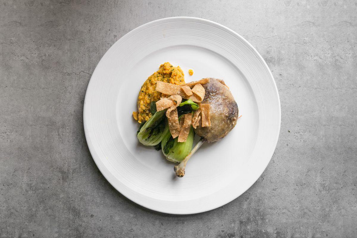 Spiced duck leg confit with lentil dhal