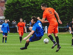 AFC Bridgnorth's Tom Grainger challenges Bilston Town's Ben Podmore Picture: Ashley Griffiths/GrifftersWorld Photography