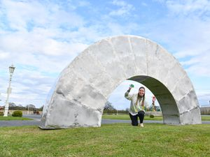 Sarah Fenn, from the British Ironwork Centre, with the rainbow sculpture