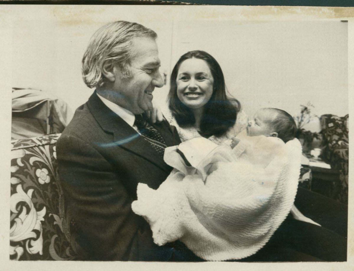 With his wife Barbara and newborn son James William John