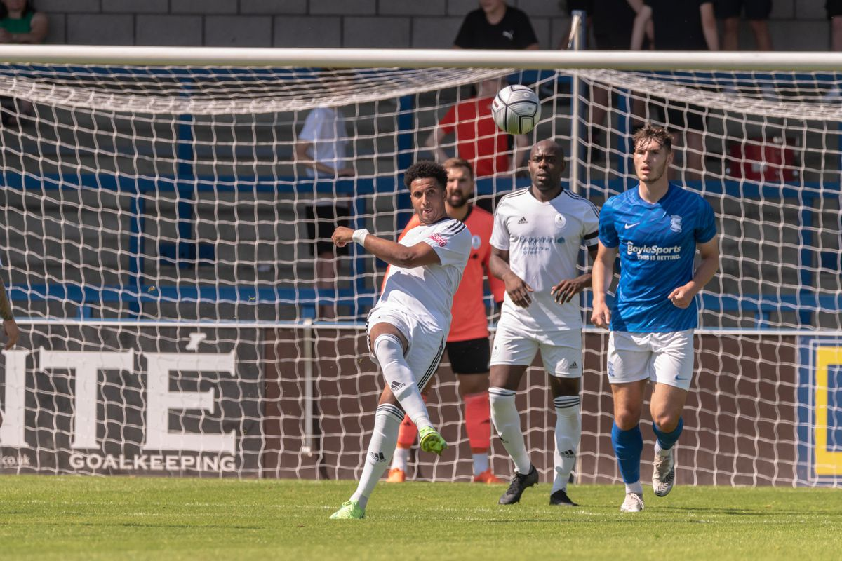 Dom McHale clearing the ball from just outside Telford Box. (Photos: Kieren Griffin Photography)