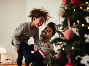 A generic stock photo of a family Christmas scene.