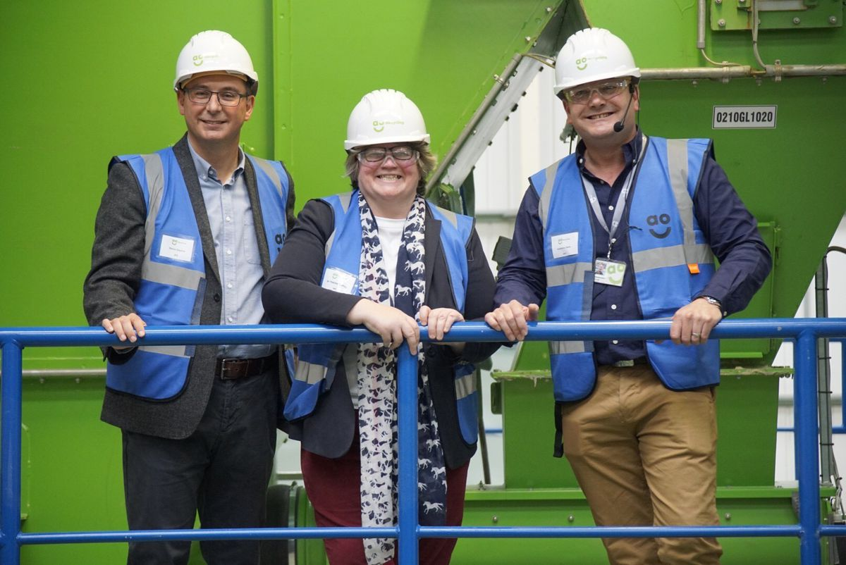 AO chief executive Steve Caunce with environment minister Therese Coffey and AO marketing director Anthony Sant
