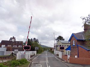 The level crossing which would go under the plans. Photo: Google StreetView.