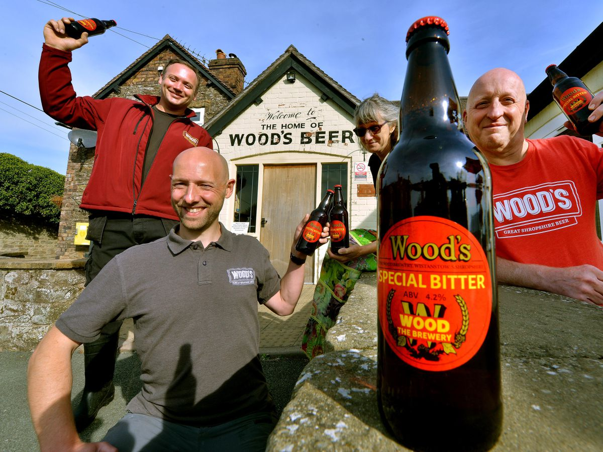 SOUTH COPYRIGHT SHROPSHIRE STAR STEVE LEATH 21/09/2021..Pic in Craven Arms at Woods Brewery where to mark 40 years they have brought back to life the old original logo and branding as a one off for there Special Bitter. L-R: Ben Watson (Brewing Asst), Andrew Pinnock (Head Brewer), Jo Varcoe (Admin Manager), MD Stephen O'Neill..